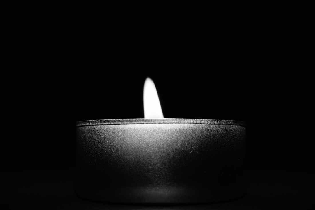 close up of candle over black background